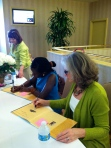 signing copies of children's book, Beatrice's Goat.